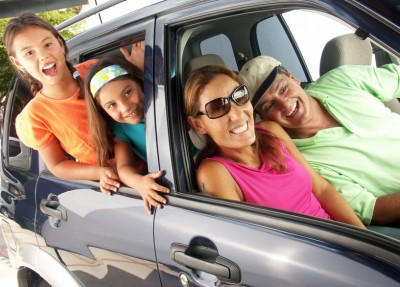 43690019 - happy family traveling on a car.